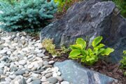 29673136-Natural-stone-landscaping-in-home-garden-Stock-Photo