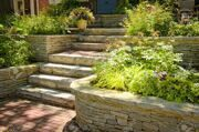 7608404-Natural-stone-landscaping-in-home-garden-with-stairs-Stock-Photo