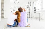 23878059-couple-at-their-new-empty-apartment-Stock-Photo